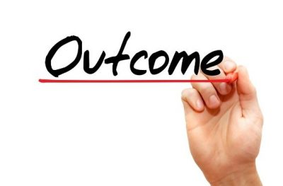 person drawing the word outcome