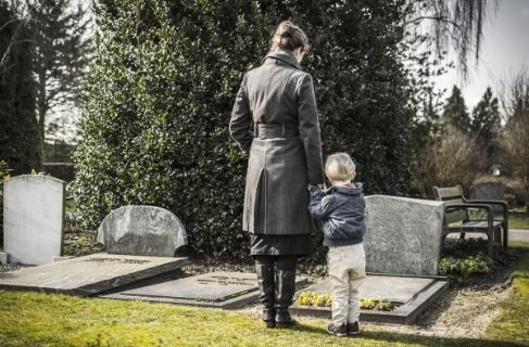 mother and child at gravesite