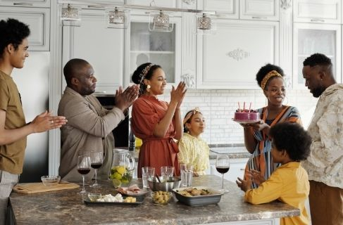 family celebrating birthday - Family Relationships in Addiction concept image